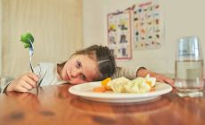 girl_refusing_to_eat_vegetables_smaller_-_iStock-599487124.jpg